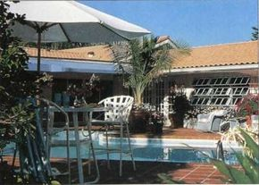 A new surface of terra cotta tile transformed this once concrete patio into an inviting poolside surround.