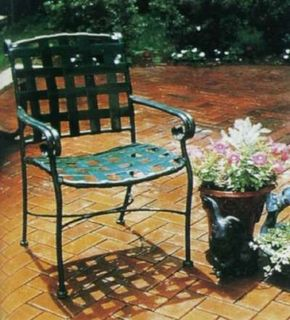 Laid in a neat herringbone pattern, this patio floor carries the orange color of new bricks.