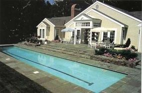 In perfect balance with the size and scale of the house and patio, this lap pool carries a crisp elegance that suits the traditional setting.