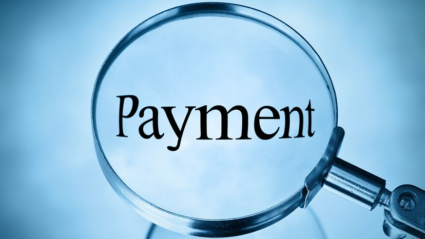 Payment under magnifying glass