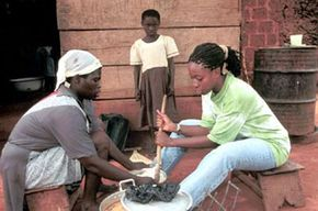 A Peace Corps volunteer cooks traditional food in Ghana.