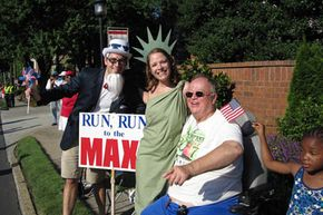 "Among the spectators: ""Uncle Sam,"" ""Lady Liberty,"" and former Georgia Sen. Max Cleland, wearing one of the coveted T-shirts, from a past race."