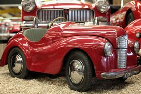 A pedal car at the Haynes Motor Museum is displayed in the Red Room, a collection of over 50 red cars, in Yeovil, England.