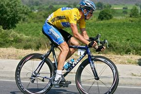 Lance Armstrong pedals during the 13th stage of the Tour de France cycling race on Friday, July 15, 2005. His efficient pedaling increases his power output.