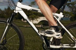 This mountain biker uses flat pedals because they offer a freedom of movement that clipless pedals don't.