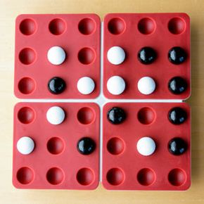 Whoever's turn it is, someone's about to win -- the player with the white marbles could complete a Triple Power Play, and the player with the black is set to score a Straight Five.