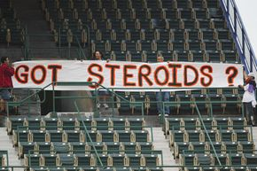 Fans hold up a sign prior to a Major League Baseball game.