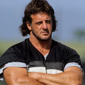 Lyle Alzado of the Los Angeles Raiders looks on at a 1990 training camp in Oxnard, California. He died of brain cancer in 1992. Alzado believed - though it wasn't proven -- the cancer was caused by steroids and HGH, which he used for more than 20 years.