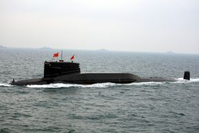 A Chinese Navy submarine slowly submerges.