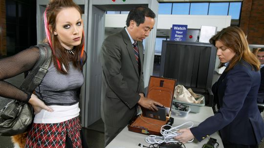 Why do you have to turn your phone on at airport security?