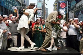 """A half-century after the fact, Carl Muscarello and Edith Shain (right) recreate the iconic pose that Alfred Eisenstaedt made famous in his 1945 """"V-J Day in Times Square"""" photo."""