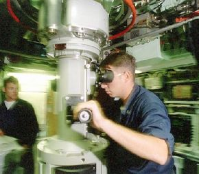 A petty officer conducts a periscope sweep prior to surfacing. Photonics masts will replace conventional periscopes.