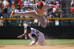 There are all sorts of forces at work in this picture, not all of them good for Brandon Phillips of the Cincinnati Reds and Dexter Fowler (below) of the Colorado Rockies. See more sports pictures.