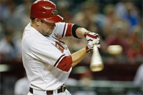 Aaron Hill, of the Arizona Diamondbacks, hopes for a successful bat-ball collision as he swings at a high fastball from Colorado Rockies pitcher Guillermo Moscoso during a game on June 5, 2012, in Phoenix.