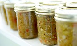 Chop your green tomatoes and combine them with hot peppers to create a relish. See more heirloom tomato pictures.