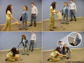 One member of the pickpocket team pretends to drop what she's carrying. When the mark stoops to help, the second pickpocket lifts her wallet from her purse.