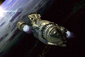 The Firefly-class transport vessel, Serenity, flies through space in 'The Message.' See more space exploration pictures.