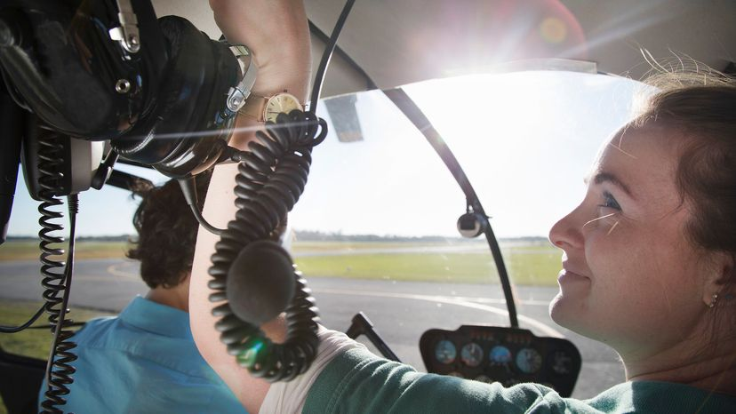 Young woman learning to be an airline pilot.