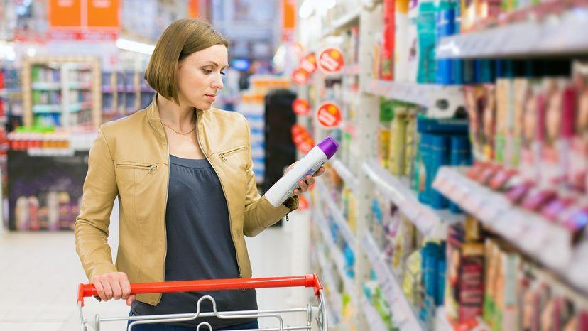woman buying shampoo