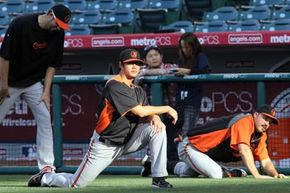 Pitcher Wei-Yin Chen of the Baltimore Orioles goes through pregame stretches in Anaheim, Calif. See more sports pictures.