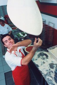 John Schnatter, the founder of Papa John's. See more pictures of international tomato dishes.