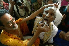 Without the aid of traditional healers like this man in India administering fish medicine to a patient in 2008, modern medicine would lack many of its most vital drugs.