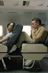 Cramped airplanes can leave your heart in a tight spot if you don't get up to move. See more heart health pictures.