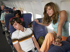 It's a good idea to get up and move around on a long flight -- even if it's a little tricky to maneuver your way out of your seat.