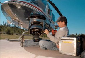 A crew member makes final preparations on the heligimbal camera rig.