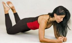 Starting position for the plank exercise, which works the entire core.