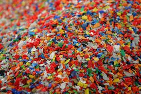 Chips from plastic soft drink and mineral water bottle tops at the end of the recycling process at the Aviv recycling plant in Israel. See more pictures of green living.