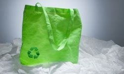 Eco bag on pile of plastic bags