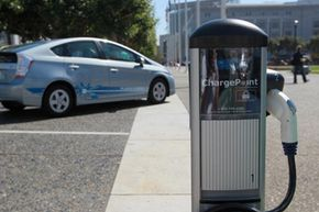 A new electric vehicle charging station is seen near San Francisco city hall in San Francisco, Calif. See more pictures of plug-in hybrids.