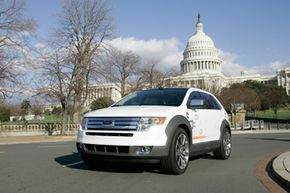 A Ford plug-in hybrid Edge cruises on Capitol Hill in Washington, on Jan. 17, 2007.