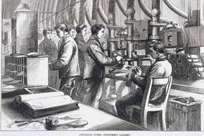 """Plate taken from the """"Illustrated London News,"""" showing men using pneumatic tubes at the Central Telegraph Establishment of the General Post Office."""