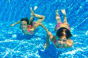 Summer is all about hanging out in the pool with your friends and playing games. See pictures of classic toys and games.