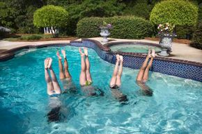 While you need skill to do a handstand on land, anyone can do it in the water.