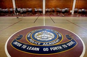 NYPD police recruits run laps.