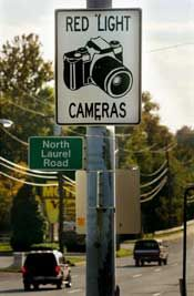 Many police cameras are installed in traffic intersections to catch people running red lights.