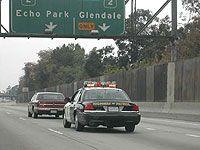 A police car pursuing a motorist.