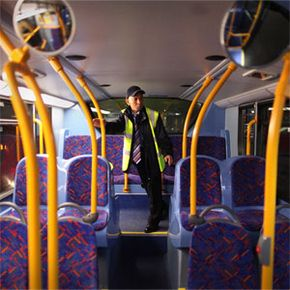 Night bus driver Chitpinit Kaewchaluay checks his bus on Dec. 15, 2010, in London, England. Chitpinit will drive the night bus from midnight until 6 a.m.