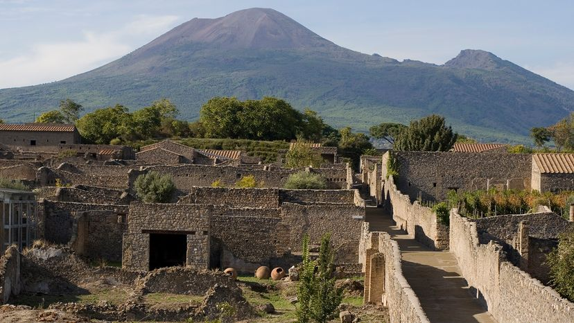 aerial view of Pompeii ruins with Mount Vesuvius in background