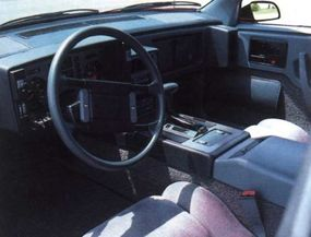 The interior of the Pontiac Fiero matched the                              exterior: it was sleek and efficient, but small.