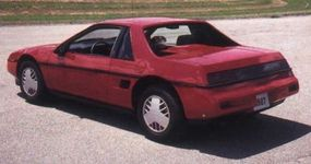 """The Pontiac Fiero GT featured """"flying buttress"""" rear roof                              supports and a slick fastback style."""