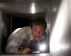 "Kurt Russell navigates an air conditioning duct in ""Poseidon."""