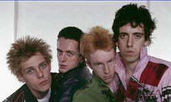 Joe Strummer (second from left), lead singer for The Clash