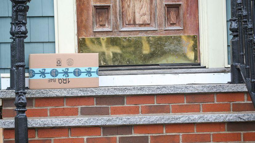 delivered package rests on a doorstep