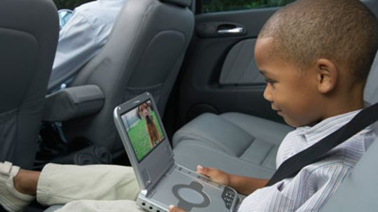 Is it more affordable to have a portable DVD player in your car or have the dealer install one?