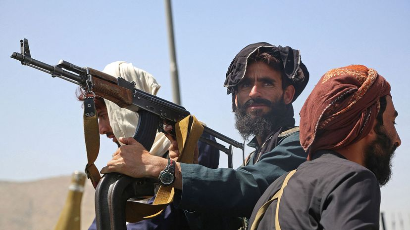 Taliban fighters stand guard