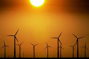 Image Gallery: Renewing the Grid A group of wind turbines are silhouetted by the setting sun on a wind farm near Montezuma, Kan. See pictures of renewing the grid.